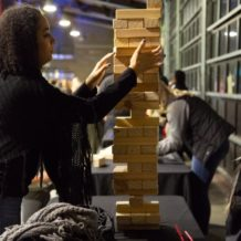 woman playing large jenga
